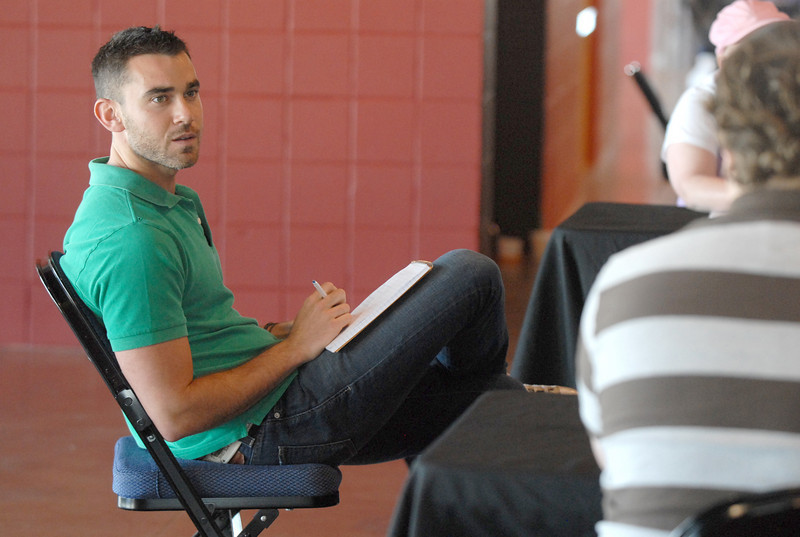 Casting director Jesse Tannenbaum listens to applicant's stories during Saturday's open casting call for The Biggest Loser 11 at Broomfield's 1st Bank Center.<br /> July 17, 2010<br /> Staff photo/ David R. Jennings