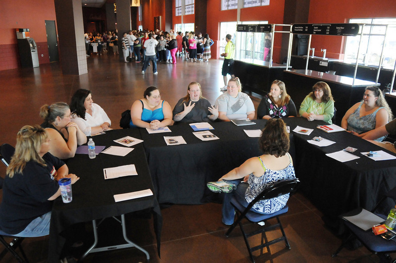 Casting Director Gina Melone, center, interviews ten applicants at a time during  Saturday's open casting call for The Biggest Loser 11 at Broomfield's 1st Bank Center.<br /> July 17, 2010<br /> Staff photo/ David R. Jennings