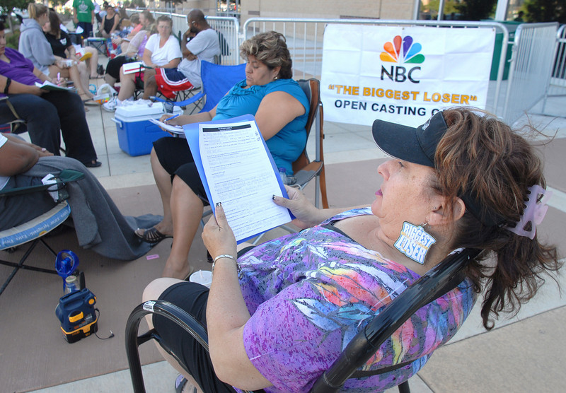 Shelly Wright checks her short form while waiting for Saturday's open casting call for The Biggest Loser 11 at Broomfield's 1st Bank Center. this is Wright's second time to apply for the show.<br /> July 17, 2010<br /> Staff photo/ David R. Jennings
