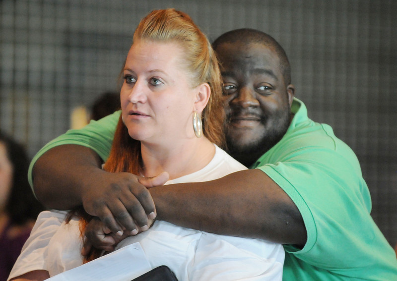 Gene Washington puts his arms around Rebecca Johnson as the couple waits to be interviewed during Saturday's open casting call for The Biggest Loser 11 at Broomfield's 1st Bank Center.<br /> July 17, 2010<br /> Staff photo/ David R. Jennings
