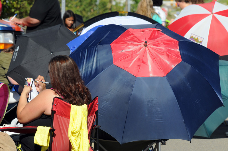 Umbrellas and applications are filled as people wait in line during Saturday's open casting call for The Biggest Loser 11 at Broomfield's 1st Bank Center.<br /> July 17, 2010<br /> Staff photo/ David R. Jennings