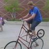 "Dylan Metz rides his ""tall  bike"" at Broomfield High School on Wednesday, which was Bike to Work Day. Metz made the bike himself. Photo submitted by John Evans"
