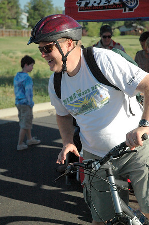 Doug Forsyth got in the spirit for Bike to Work Day on Wednesday by wearing a T-shirt from a past year's event. Photo by Dylan Otto Krider/Broomfield Enterprise