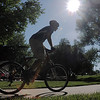 A bicycle commuter leaves the East Park breakfast stop during Bike To Work Day on Wednesday.<br /> <br /> June 22, 2011<br /> staff photo/David R. Jennings