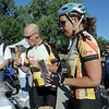 Gavin Slater, left, and Amy Thomas with Key Equipment Finace sample the food and coffee offered to commuters by Loftea Cafe during Bike To Work Day at East Park on Wednesday.<br /> <br /> June 22, 2011<br /> staff photo/David R. Jennings