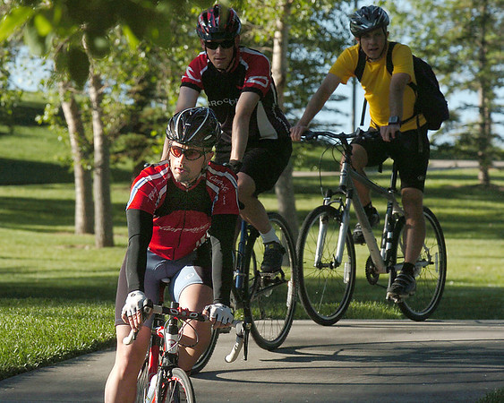 Paul Stone, who commutes form Broomfield to Boulder daily, rides to the East Park breakfast stop during Bike To Work Day on Wednesday.<br /> <br /> June 22, 2011<br /> staff photo/David R. Jennings