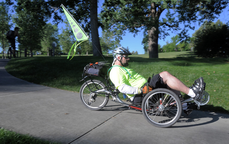 Chris Wright rides his recumbant bicycle to the breakfast stop at East Park  during Bike To Work Day on Wednesday.<br /> <br /> June 22, 2011<br /> staff photo/David R. Jennings