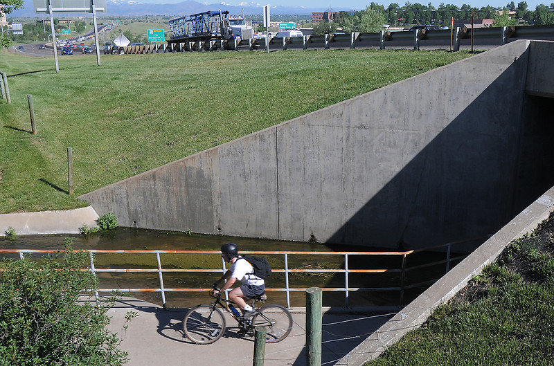 A bicycle commuter travels under US 36 to the East Park breakfast stop during Bike To Work Day on Wednesday.<br /> <br /> June 22, 2011<br /> staff photo/David R. Jennings