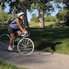 Monica Perez rides to the East Park breakfast stop on heer commute from Arvada to Interlocken during Bike To Work Day on Wednesday.<br /> <br /> June 22, 2011<br /> staff photo/David R. Jennings