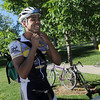 Diran Ayandele puts on his helmet after stopping at the East Park breakfast stop on his commute from Louisville to Oracle during Bike To Work Day on Wednesday.<br /> <br /> June 22, 2011<br /> staff photo/David R. Jennings