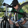 Ed Post a mechanic with Golden Bear Bikes works on a commuter's bicyce during Bike To Work Day at East Park on Wednesday.<br /> <br /> June 22, 2011<br /> staff photo/David R. Jennings