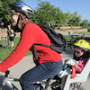 Tricia Haugeto continues her commute to Boulder from Broomfield with her daughter Jenna, 2, after taking a breakfast stop during Bike To Work Day at East Park on Wednesday.<br /> <br /> June 22, 2011<br /> staff photo/David R. Jennings