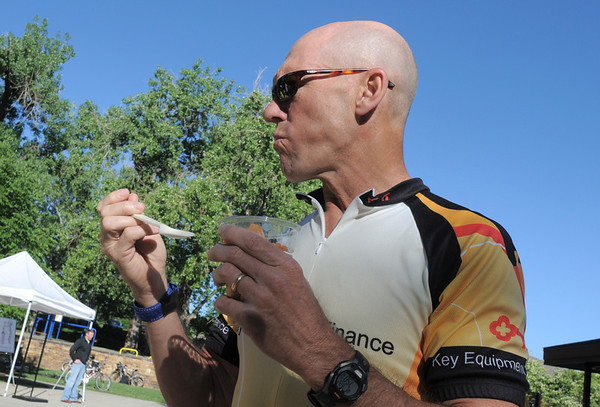 Gavin Slater with Key Equipment Finance eats a dish of yogurt covered cantelope for breakfast at the Loftea Cafe booth during Bike To Work Day at East Park on Wednesday.<br /> <br /> June 22, 2011<br /> staff photo/David R. Jennings