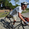 "Hans Jordan hops on is bicycle after stopping at the breakfast station during Bike to Work Day at East Park on Wednesday.<br /> June27, 2012<br /> staff photo/ David R. Jennings<br /> <br /> for more photos and video please go to  <a href=""http://www.broomfieldenterprise.com"">http://www.broomfieldenterprise.com</a>"