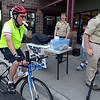 """Steven Garn eats a banana  while a quick stop at the Golden Bear Bikes station during Bike to Work Day on Wednesday.<br /> <br /> June27, 2012<br /> staff photo/ David R. Jennings<br /> <br /> for more photos and video please go to  <a href=""""http://www.broomfieldenterprise.com"""">http://www.broomfieldenterprise.com</a>"""
