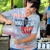 "Kathleen Gilliland with Optimal Health, pours smoothies for bicycle commuter the breakfast station at East Park  during Bike to Work Day on Wednesday.<br /> <br /> <br /> June27, 2012<br /> staff photo/ David R. Jennings<br /> <br /> for more photos and video please go to  <a href=""http://www.broomfieldenterprise.com"">http://www.broomfieldenterprise.com</a>"