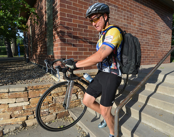 "Dave Asmus carries his bicycle down the stairs to the breakfast station during Bike to Work Day at East Park on Wednesday.<br /> <br /> June27, 2012<br /> staff photo/ David R. Jennings<br /> <br /> for more photos and video please go to  <a href=""http://www.broomfieldenterprise.com"">http://www.broomfieldenterprise.com</a>"