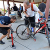 "Golden Bear Bikes mechanic Abe Martin, checks the air in Craig Swak's , Southwest Wind Power, tire during Bike to Work Day at East Park on Wednesday.<br /> <br /> June27, 2012<br /> staff photo/ David R. Jennings<br /> <br /> for more photos and video please go to  <a href=""http://www.broomfieldenterprise.com"">http://www.broomfieldenterprise.com</a>"