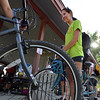 "Melori Arellano on her way to work at VM Wear,  waits to have her bicycle checked  during Bike to Work Day at East Park on Wednesday.<br /> <br /> June27, 2012<br /> staff photo/ David R. Jennings<br /> <br /> for more photos and video please go to  <a href=""http://www.broomfieldenterprise.com"">http://www.broomfieldenterprise.com</a>"