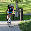 "Trish Heisdorffer rides to the breakfast station at East Park on her way to work at Level 3 during Bike to Work Day on Wednesday.<br /> <br /> June27, 2012<br /> staff photo/ David R. Jennings<br /> <br /> for more photos and video please go to  <a href=""http://www.broomfieldenterprise.com"">http://www.broomfieldenterprise.com</a>"