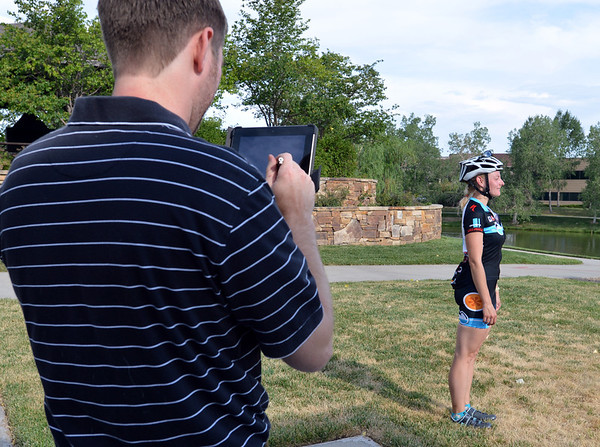 """Morgan Landers poses for a picture by Dr. Chris Stull, D.C. during Bike to Work Day at East Park on Wednesday.<br /> June27, 2012<br /> staff photo/ David R. Jennings<br /> <br /> for more photos and video please go to  <a href=""""http://www.broomfieldenterprise.com"""">http://www.broomfieldenterprise.com</a>"""
