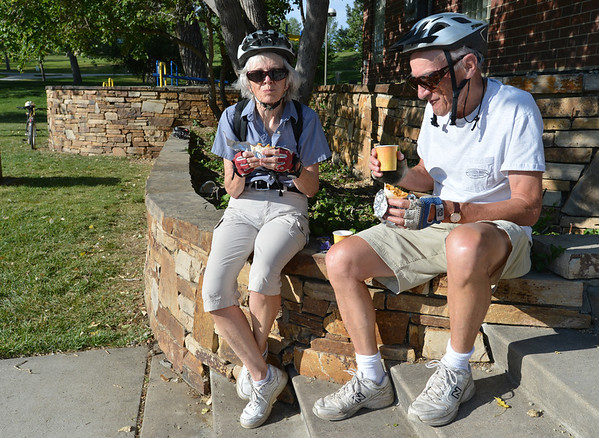 "Joan Mulcahy, left, and Hans Jordan enjoy their breakfast on Joan's way to work at Oracle during Bike to Work Day at East Park on Wednesday.<br /> <br /> June27, 2012<br /> staff photo/ David R. Jennings<br /> <br /> for more photos and video please go to  <a href=""http://www.broomfieldenterprise.com"">http://www.broomfieldenterprise.com</a>"