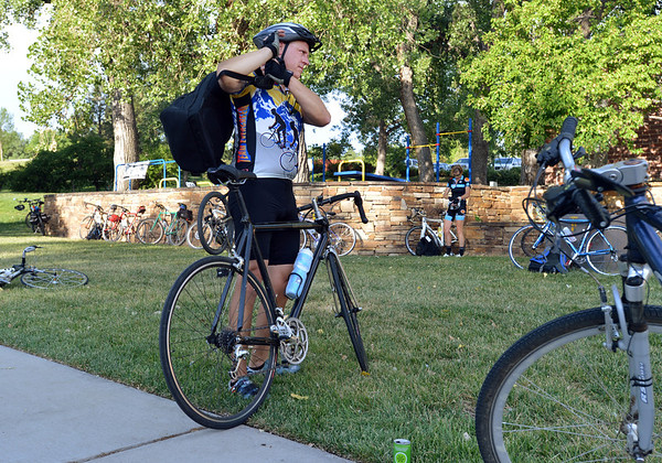"Dave Asmus prepares to keep traveling to work  during Bike to Work Day at East Park on Wednesday.<br /> <br /> June27, 2012<br /> staff photo/ David R. Jennings<br /> <br /> for more photos and video please go to  <a href=""http://www.broomfieldenterprise.com"">http://www.broomfieldenterprise.com</a>"
