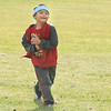 Bryant Shije runs in the kindergarden race during Birch Elementary School's Bulldog Jog fundraiser on Friday.<br /> October 9, 2009<br /> Staff photo/David R. Jennings