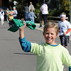 Micah Bratach waves his fourth grade bandana  while approaching the finish line during Birch Elementary's Bulldog Jog fundraiser on Friday.<br /> October 9, 2009<br /> Staff photo/David R. Jennings