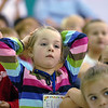 First grader Elizabeth Richardson listens to principal Tracy Stegall speak at the Welcome Rally at Birch Elementary School on Friday.<br /> <br /> August 21, 2009<br /> staff photo/David R. Jennings