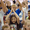 Second grader Josephine Fossaeca, center, gestures during a song the Welcome Rally at Birch Elementary School on Friday.<br /> <br /> August 21, 2009<br /> staff photo/David R. Jennings