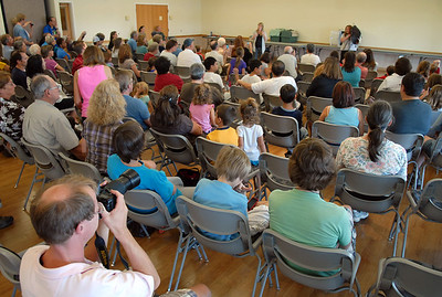 Members of the audience listen and take pictures during the Birds of Prey Foundation presentation for the Broomfield Open Space Foundation at the Broomfield Community Center on Saturday. September 24, 2011 staff photo/ David R. Jennings