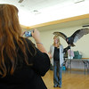 A member of the audience takes a picture of Rachel Mansfield holding Chuck, a turkey Vulture, during the Birds of Prey Foundation presentation for the Broomfield Open Space Foundation at the Broomfield Community Center on Saturday.<br /> September 24, 2011<br /> staff photo/ David R. Jennings