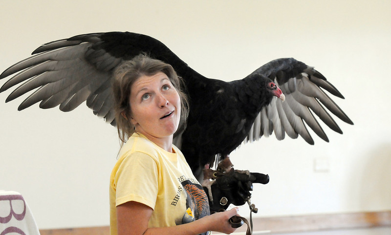 Rachel Mansfield, assistant director of the Broomfield based Birds of Prey Foundation explains to an audience of nearly 200 people how Chuck, a Turkey Vulture, seems to know he's handsome during the presentation at the Broomfield Community Center on Saturday.<br /> <br /> September 25, 2010<br /> staff photo/David R. Jennings