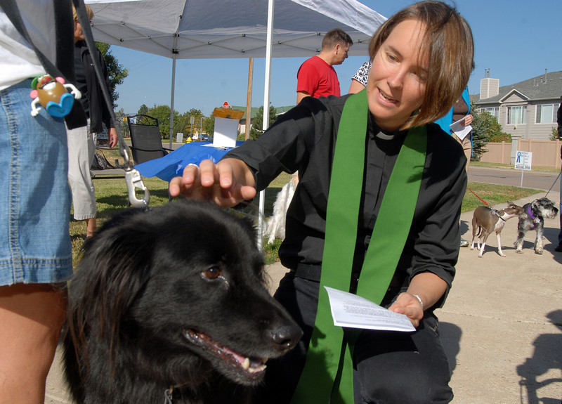 Rev. Kim Seidman, Holy Comforter Episcopal Church, blesses Bert owned by Vicki Gullickson during the blessing of the animals on the front lawn of the church on Saturday.<br /> <br /> October 2, 2010<br /> staff photo/David R. Jennings