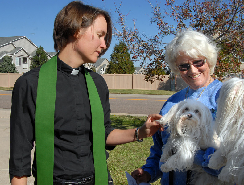 Rev. Kim Seidman, Holy Comforter Episcopal Church, blesses Sushi Rama being held by owner Sally Huffman during the blessing of the animals on the front lawn of the church on Saturday.<br /> <br /> October 2, 2010<br /> staff photo/David R. Jennings