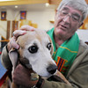 Reverand Dr. Rod Moore blesses Tippy owned by Jeff and Monette Jo during the Blessing of the Animals and St. Francis Festival at The Church of the Holy Comforter on Saturday. Over 30 dogs, 1 cat and 1 gecko received the blessing in the church sanctuary.<br /> October 10, 2009<br /> Staff photo/David R. Jennings