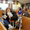 Donna Dudley gives Monty a kiss as they sit with Scottie during the  the Blessing of the Animals service at The Church of the Holy Comforter on Saturday. Over 30 dogs, 1 cat and 1 gecko received the blessing in the church sanctuary.<br /> October 10, 2009<br /> Staff photo/David R. Jennings