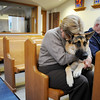 Freda, a therapy dog, sits on the lap of owners Karen Brasselero and her husband Mike while praying during the Blessing of the Animals and St. Francis Festival at The Church of the Holy Comforter on Saturday. Over 30 dogs, 1 cat and 1 gecko received the blessing in the church sanctuary.<br /> October 10, 2009<br /> Staff photo/David R. Jennings
