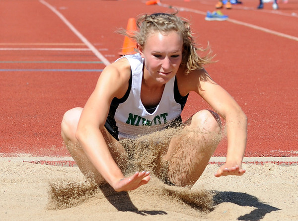 Niwot's Sara Bishop in the triple jump at the 36th Annual Boulder County Track and Field Championships at Elizabeth Kennedy Stadium in Broomfield on Saturday.<br /> <br /> April 21, 2012 <br /> staff photo/ David R. Jennings