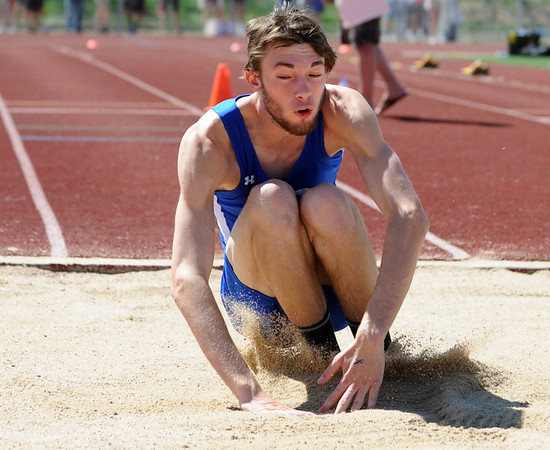 Broomfield's Jayson Dupre in the triple jump at the 36th Annual Boulder County Track and Field Championships at Elizabeth Kennedy Stadium in Broomfield on Saturday.<br /> <br /> April 21, 2012 <br /> staff photo/ David R. Jennings