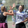 Silver Creek's Jade Vandersteen, left, congratulates Boulder's Zoe Robb in the pole vault at the 36th Annual Boulder County Track and Field Championships at Elizabeth Kennedy Stadium in Broomfield on Saturday.<br /> <br /> April 21, 2012 <br /> staff photo/ David R. Jennings