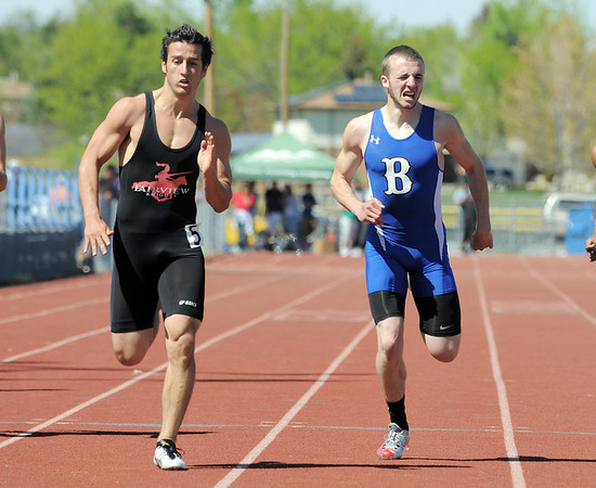 Fairview's Ben Meyer, edges out Broomfield's Harrison Einspahr in the 200m dash at the 36th Annual Boulder County Track and Field Championships at Elizabeth Kennedy Stadium in Broomfield on Saturday.<br /> <br /> April 21, 2012 <br /> staff photo/ David R. Jennings