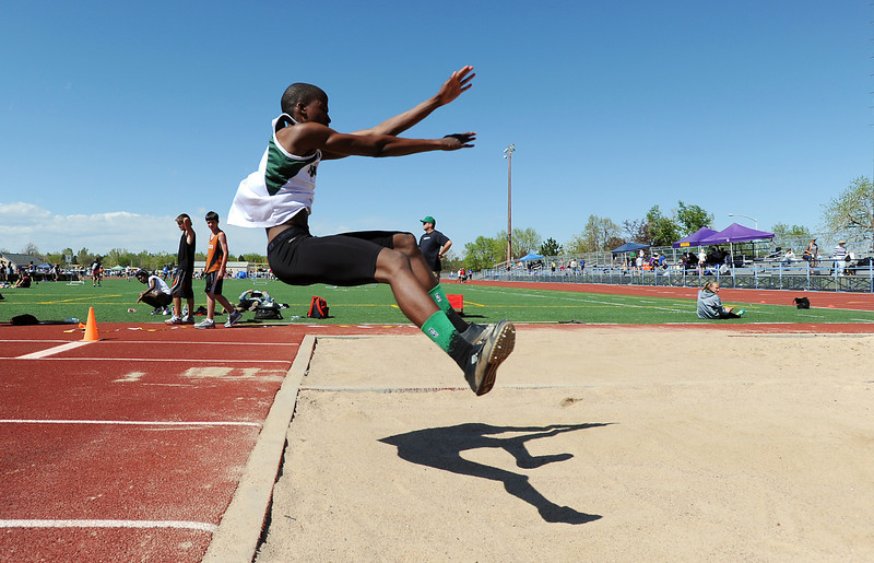 Lorne Jenkins, Niwot, in the triple jump at the 36th Annual Boulder County Track and Field Championships at Elizabeth Kennedy Stadium in Broomfield on Saturday.<br /> <br /> April 21, 2012 <br /> staff photo/ David R. Jennings