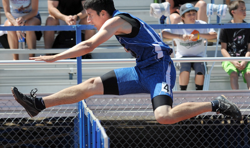 Longmont's Braden Hitchcock in the 300m hurdles the 36th Annual Boulder County Track and Field Championships at Elizabeth Kennedy Stadium in Broomfield on Saturday.<br /> <br /> April 21, 2012 <br /> staff photo/ David R. Jennings