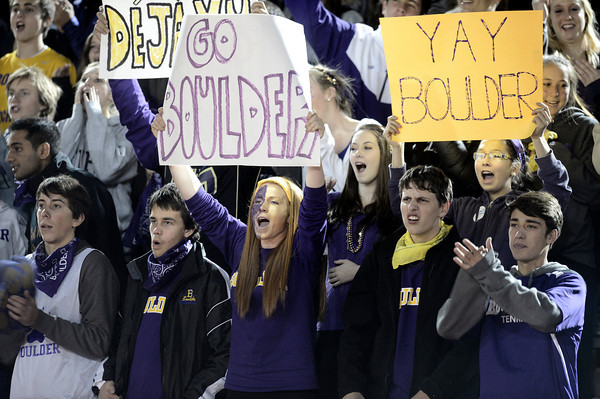 """Boulder High School senior Katie Simpson, at center, cheers for Boulder during a semi-final soccer game against Fairview High School on Wednesday, Nov. 7, at Legacy Stadium in Aurora. For more photos of the game go to  <a href=""""http://www.dailycamera.com"""">http://www.dailycamera.com</a><br /> Jeremy Papasso/ Camera"""