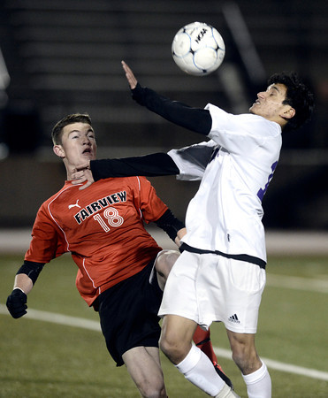 "Boulder High School's Rojan Shrestha, right, fights for the ball with Nick Porter during a semi-final game against Fairview High School on Wednesday, Nov. 7, at Legacy Stadium in Aurora. For more photos of the game go to  <a href=""http://www.dailycamera.com"">http://www.dailycamera.com</a><br /> Jeremy Papasso/ Camera"