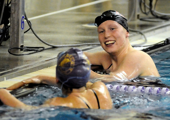 BHFVSWIM<br /> Fairview's Emily Scraggs talks to Siobhan Hengemuhle after swimming the 50 freestyle during a Boulder High vs. Fairview swim meet on Thursday.<br /> Photo by Marty Caivano/Camera/Jan. 7, 2010