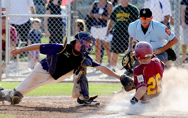 "Nate Marcotte of Boulder is late with the tag on Cole Anderson of the Rocky Mountain Lobos on Saturday.<br /> For  more photos of the game, go to  <a href=""http://www.dailycamera.com"">http://www.dailycamera.com</a>.<br /> Cliff Grassmick  / August 4, 2012"