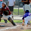 "Tommy Baumgartner of Boulder scores before catcher, Marcus Bean of the Lobos gets the throw.<br /> For  more photos of the game, go to  <a href=""http://www.dailycamera.com"">http://www.dailycamera.com</a>.<br /> Cliff Grassmick  / August 4, 2012"